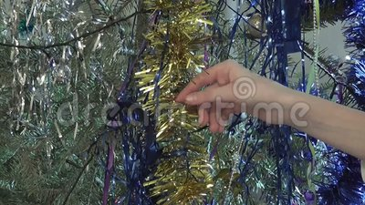 Girl touch Christmas decoration, only hand. S. Christmas tree stock video footage