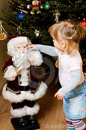 Girl touching Santa Claus