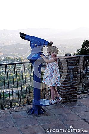 Girl tourist binoculars