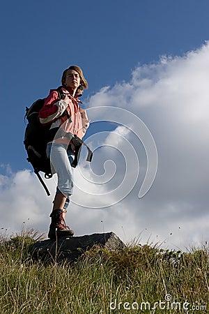 Girl tourist exploring the mountains.
