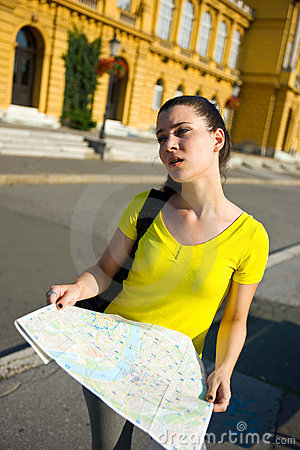Girl tourist with map lost and tired
