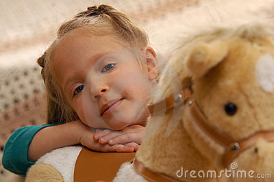 Girl With Toy Horse