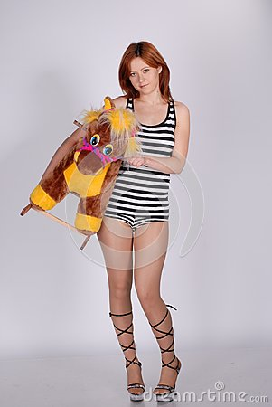Girl With Toy Horse Royalty Free Stock Photo - Image: 9868895