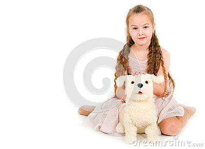 The girl with a toy puppy