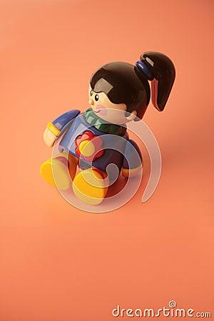 Girl toy sitting smiling