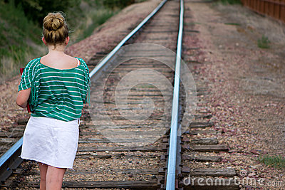 Girl on tracks