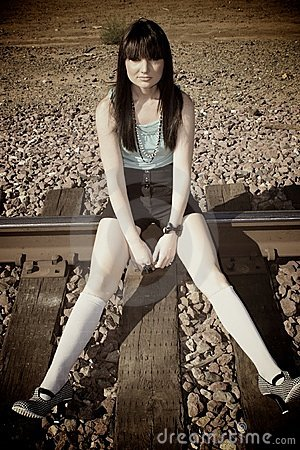 Girl on the train tracks