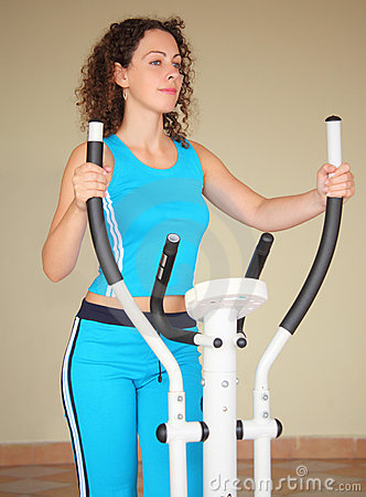 Girl on training apparatus