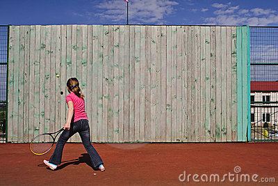 The girl trains to play tennis.