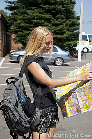 The girl-traveller with a map