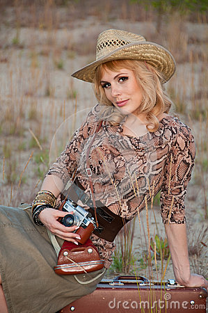 A girl travels in a cowboy hat