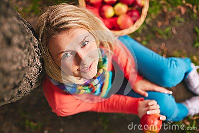 Girl by tree trunk