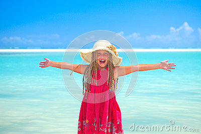 Girl at tropical beach happy