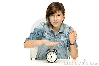 Girl turning off alarm clock