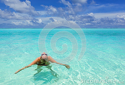 Girl in the turquoise sea