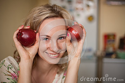 Girl with two apple
