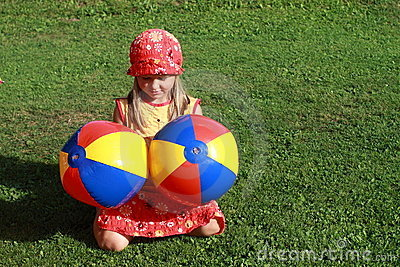 Girl with two colorful balls