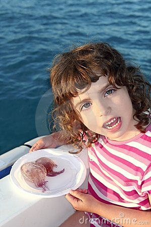 Girl with two jellyfish in boat blue sea