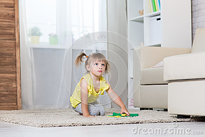 A girl of two years playing. Stock Photo