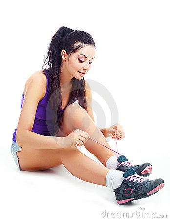 Girl tying shoelaces