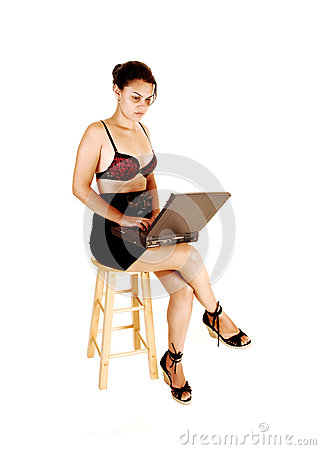 Girl typing on laptop.