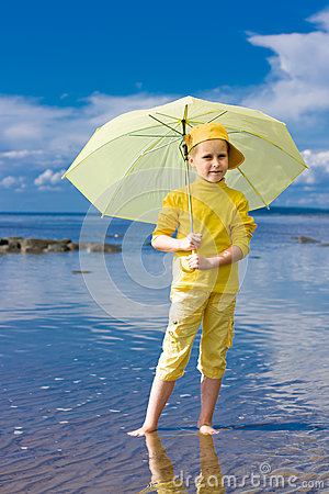 Girl with umbrella on a beach