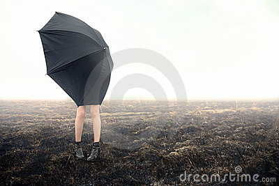 Girl with umbrella on black field