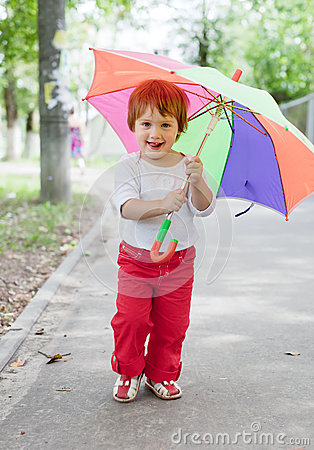 Girl  with umbrella in summer street