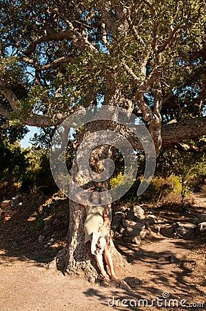 Girl under cork tree