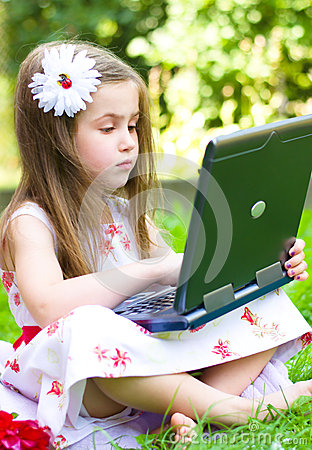 Girl using her laptop outdoor