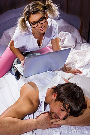 Girl using a laptop on her boyfriend`s back
