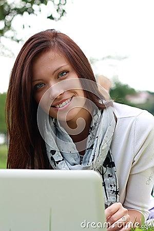 Girl using laptop outdoors