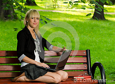 Girl using a laptop studying for the exam