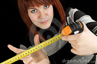 Girl using a measuring tape tool