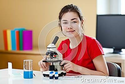Girl using microscope