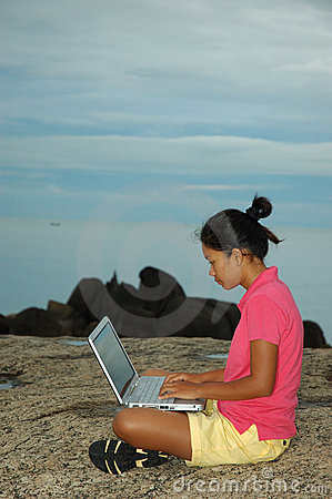 Girl Using Notebook Outside on Rocks