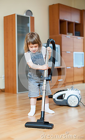 Girl with vacuum cleaner
