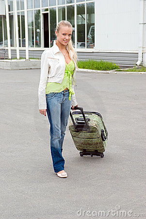Girl with valise.
