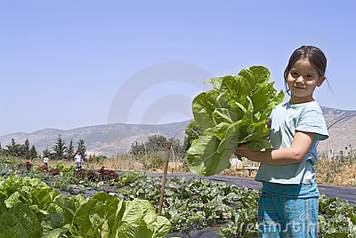 Girl in vegetebale garden