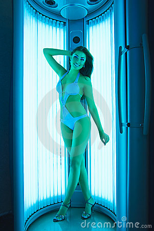 Girl at vertical solarium