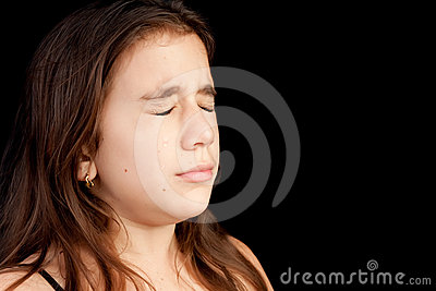 Girl with a very sad face crying