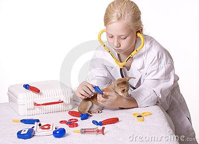 Girl Veterinarian with Puppy and Tweezers