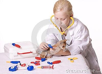 Girl Veterinarian with Puppy and Tweezers