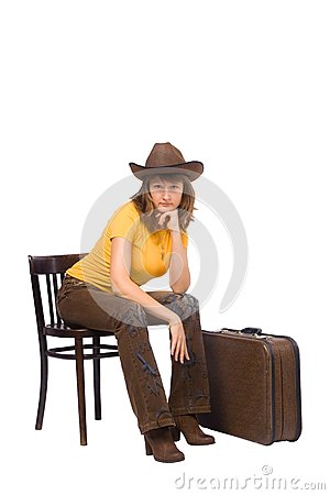 Girl with vintage suitcase is ready to go