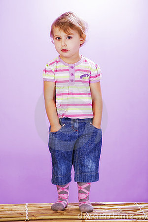 Girl on a violet background, hands in pocket