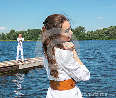 Girl waiting for her boyfriend. The guy holding the boat with re