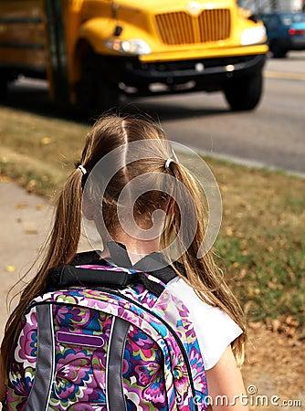 Girl waiting for school bus