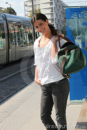 Girl waiting for the tram