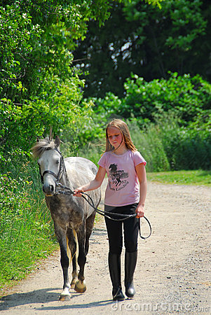 Free Girl Walk Pony Stock Image - 1327921