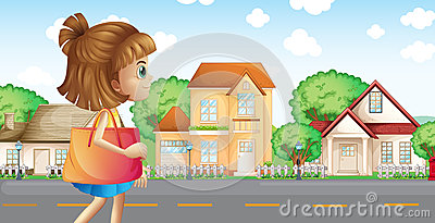 A girl walking across the neighborhood